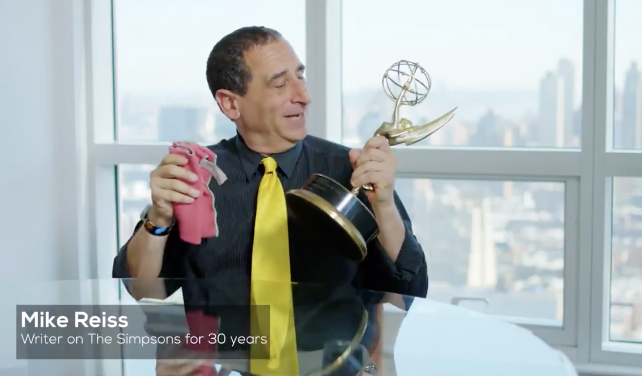 The Simpsons writer Mike Reiss with an Emmy Award trophy.