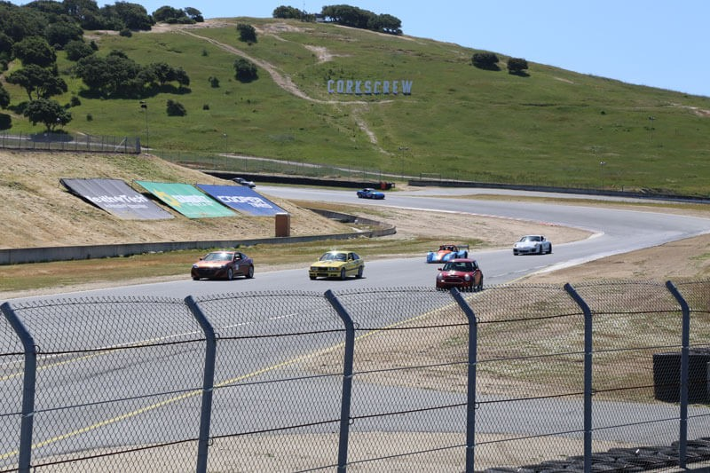 Jon Walton races past Corkscrew, a dramatic set of turns that drop the equivalent of a 10-story building in a short distance at WeatherTech Raceway Laguna Seca in Monterey, Calif.