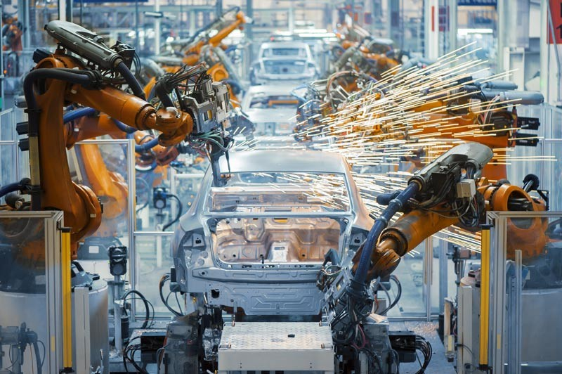 Robot assembly line welding an automobile.