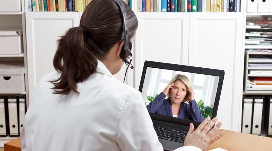 doctor headset laptop patient headache